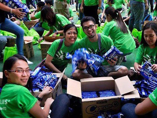 A group of green-shirted TELUS volunteers