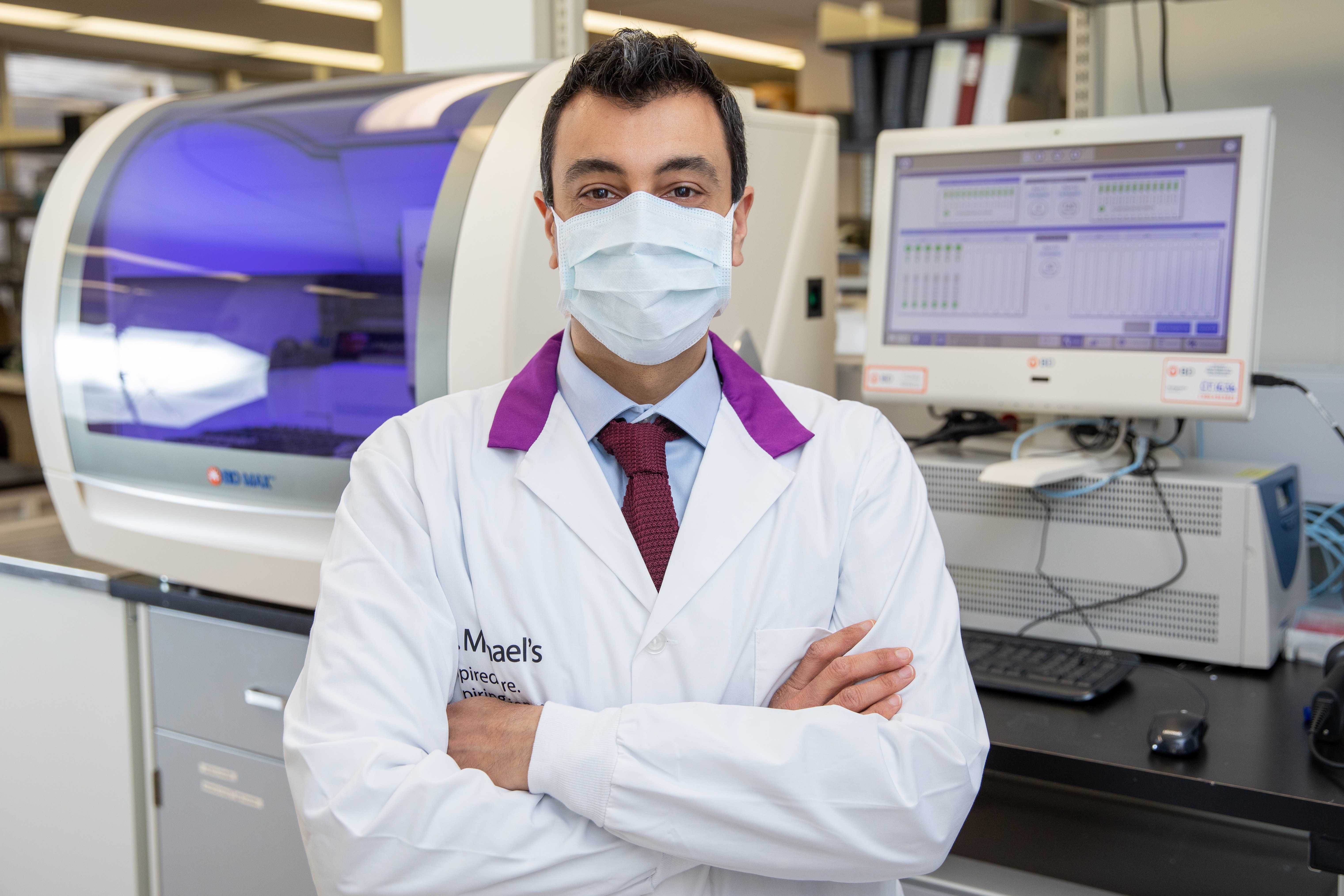 Doctor standing in front of medical machinery