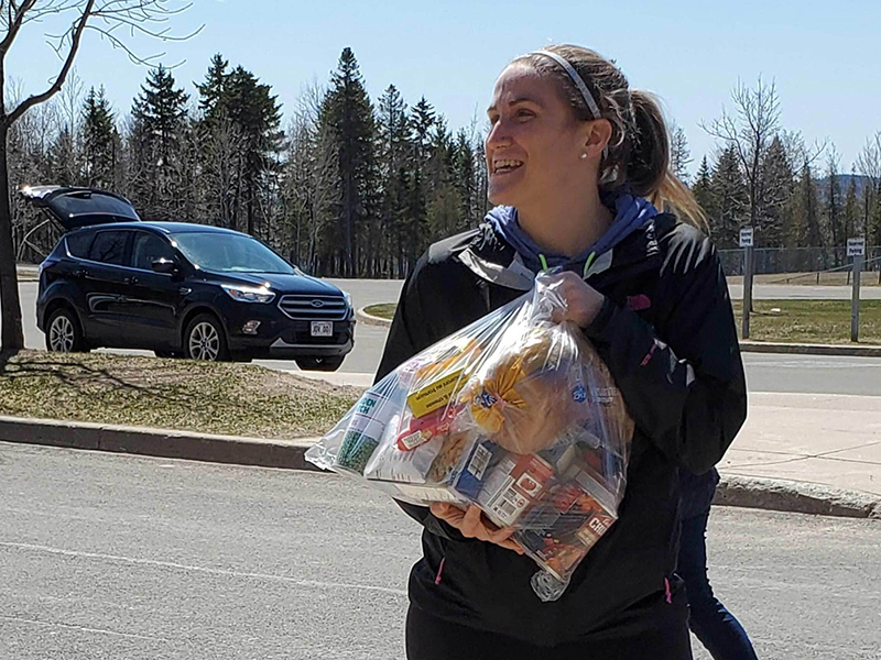 Fredericton Community Kitchens executive director, Cassandra Blackmore, holding a bag of food destined for delivery