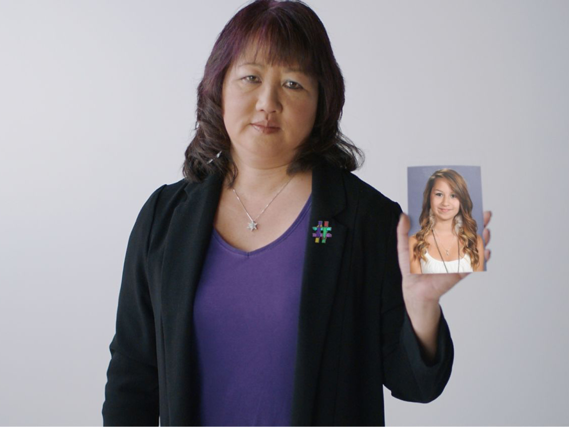 Carol Todd holding up a photo of her deceased daughter, Amanda