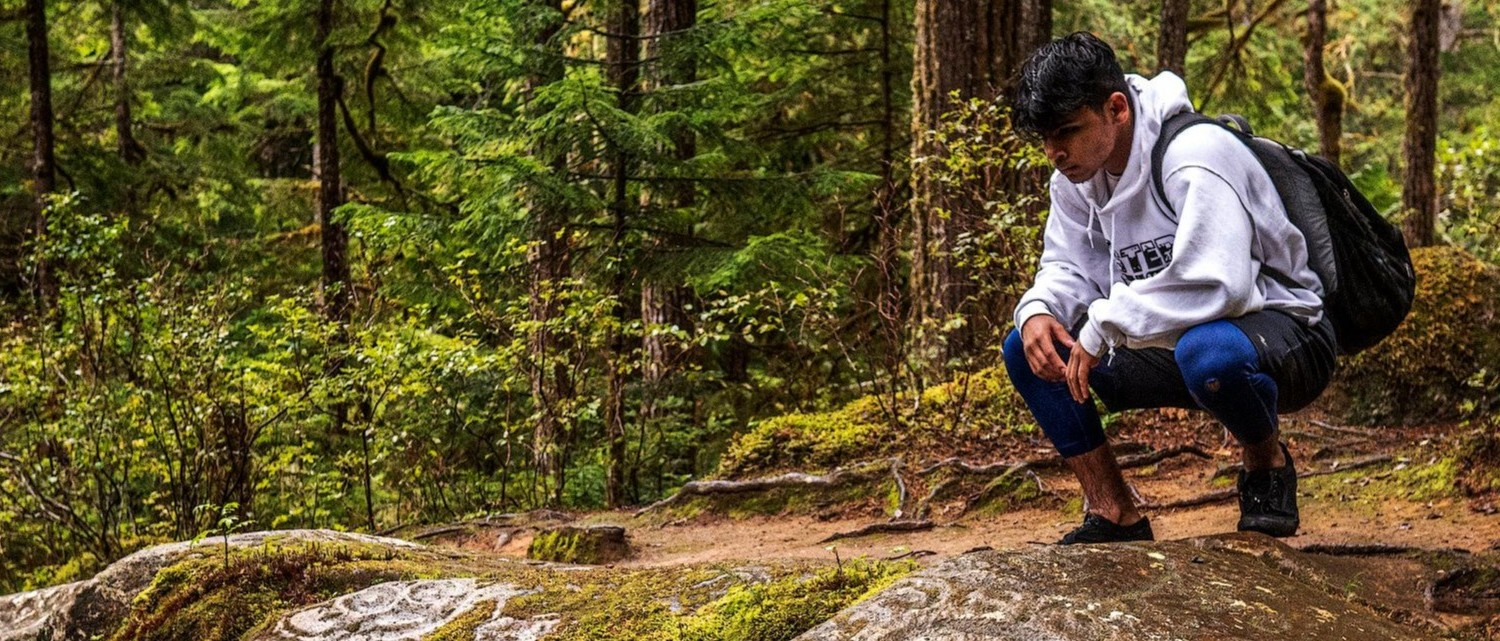 Young man hiking in the woods