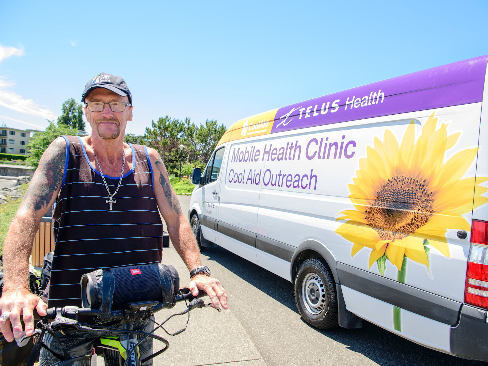 Garry standing in front of the TELUs Health/Cool Aid Mobile Health Clinic van