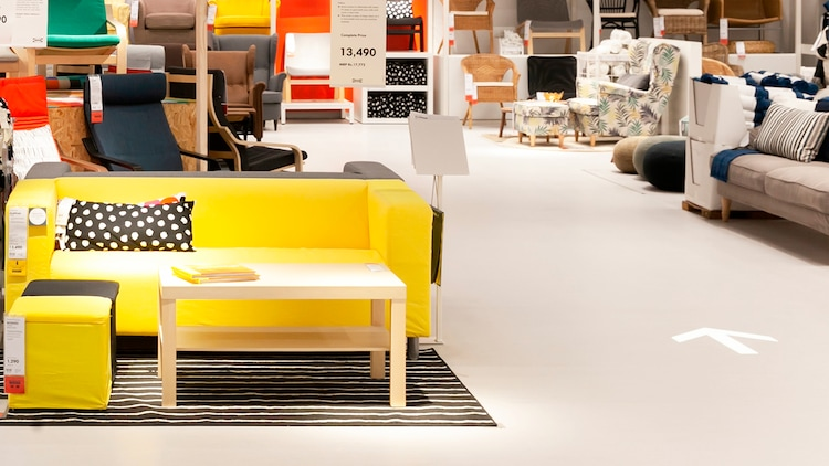 An image of an IKEA store, displaying the arrows inside the store to direct customers.