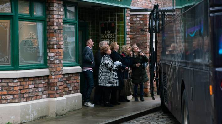 Rita, Ken, Gail and a group of other residents outside The Rovers - Coronation Street - ITV