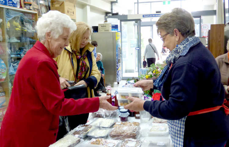 Lyn Freudenstein selling slices at the Hospital Auxiliary Stall