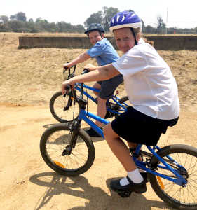 Billy Corkhill (Year 3) and Willow Stevenson (Year 4) on the BMX track