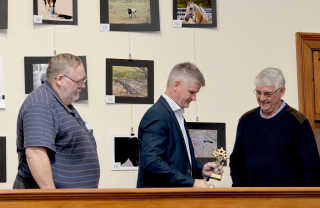 Bob Green being presented with the Champion Print trophy by Mayor Brian Ingram and HMCC President Alan Salmon.