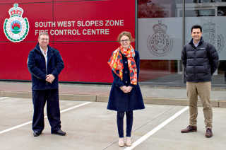 Inspector Tom McDevitt, Steph Cooke MP and  Darren Hession from PWA and Zauner Constructions at the RFS Control Centre in Harden.