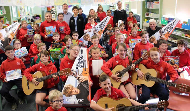 Students at Boorowa Central School receiving their guitars.