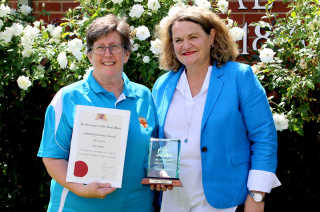 Award recipient Julie Poplin and state member Wendy Tuckerman
