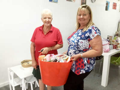 Heather Bailey (President of Young Women's Bowling Club) presenting donated toiletries to Women's Crisis Centre manager, Gwen-Gunning.