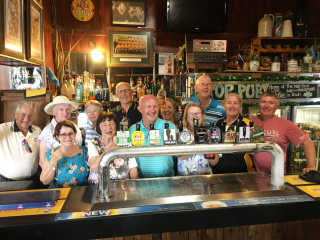 The visiting Club members of Camden (President Stephen Humphreys-front middle) with Boorowa Rotarian Jenny Carter (white hat).