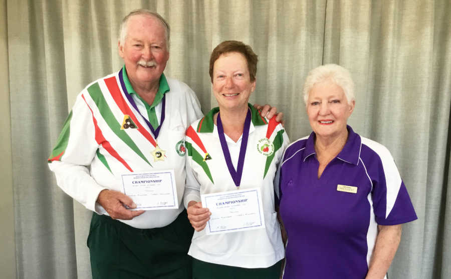 SW District Mixed Pairs winners Terry and Judith Mulligan being presented with their winning certificates and medals by SWD Women's Bowls Association President, Heather Bailey.