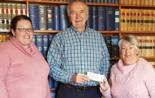 Tracy Clark and Carole Clark presenting Eris Gleeson with the cheque.