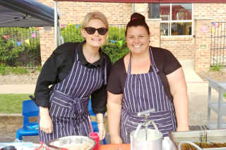 Bunyip Staff Molly Maloney and Sigrid Stevens making donuts