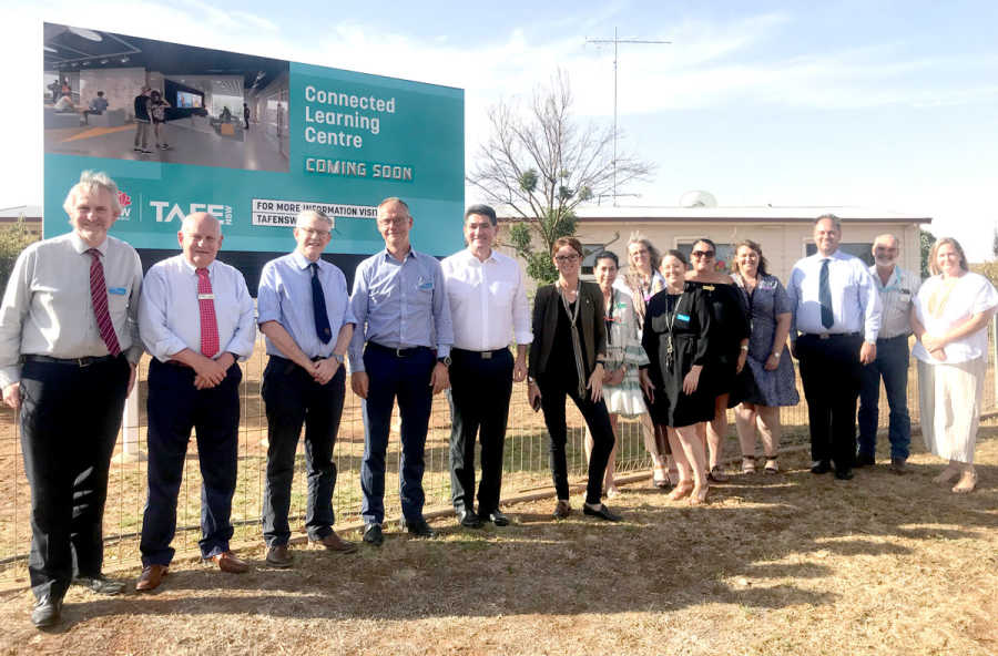 Steph Cooke and Minister Geoff Lee with West Wyalong TAFE staff.