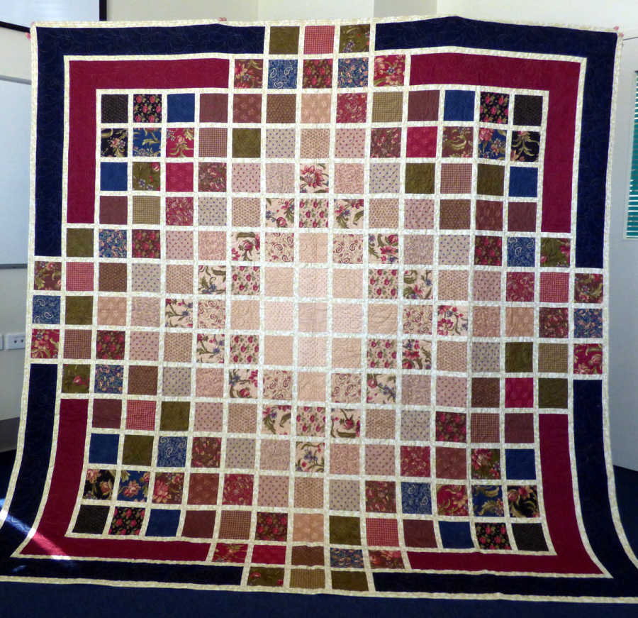 The raffle first prize is this beautiful quilt.