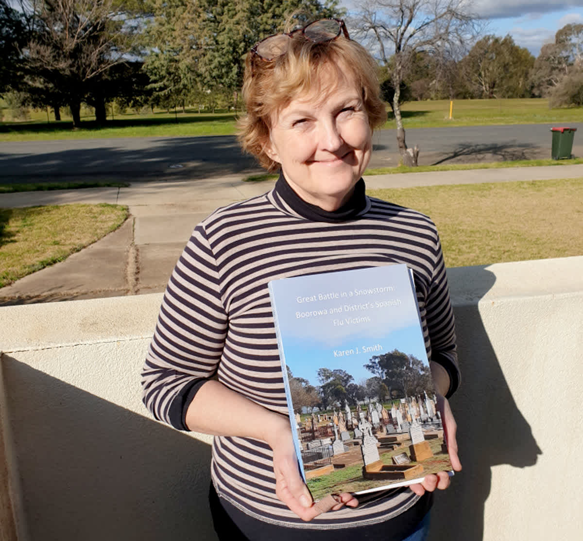 Author Karen Smith with her book.
