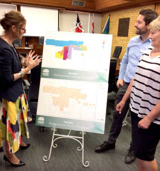 Steph Cooke MP with Facility Manager Kerry Menz and Nicolas Di Condio from Health Infrastructure reviewing the floor plans.