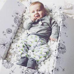Baby liegt in der LILLYDOO Monatsbox