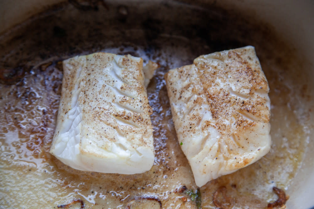 Season fish filets with salt and pepper and brown them lightly with the shallots. When browned (they do not need to be cooked through), remove filets to a plate and set aside.