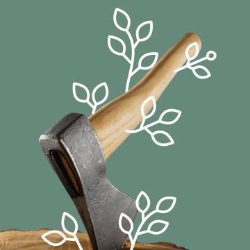 Axt, die in einem Holzstück steckt