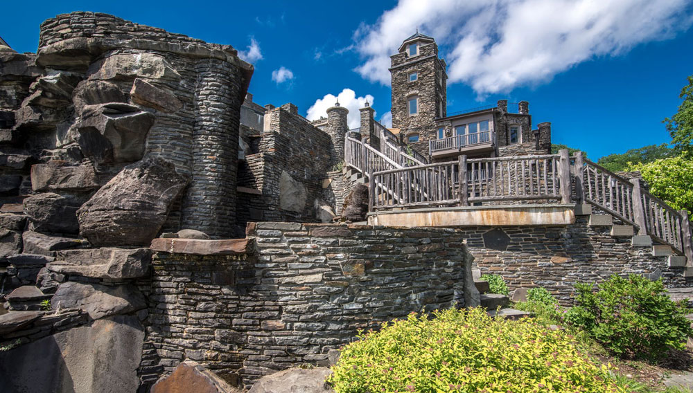 The Main House Is Reminiscent Of Irish Castles Thanks To Its Fortified Stone Facade And Turret