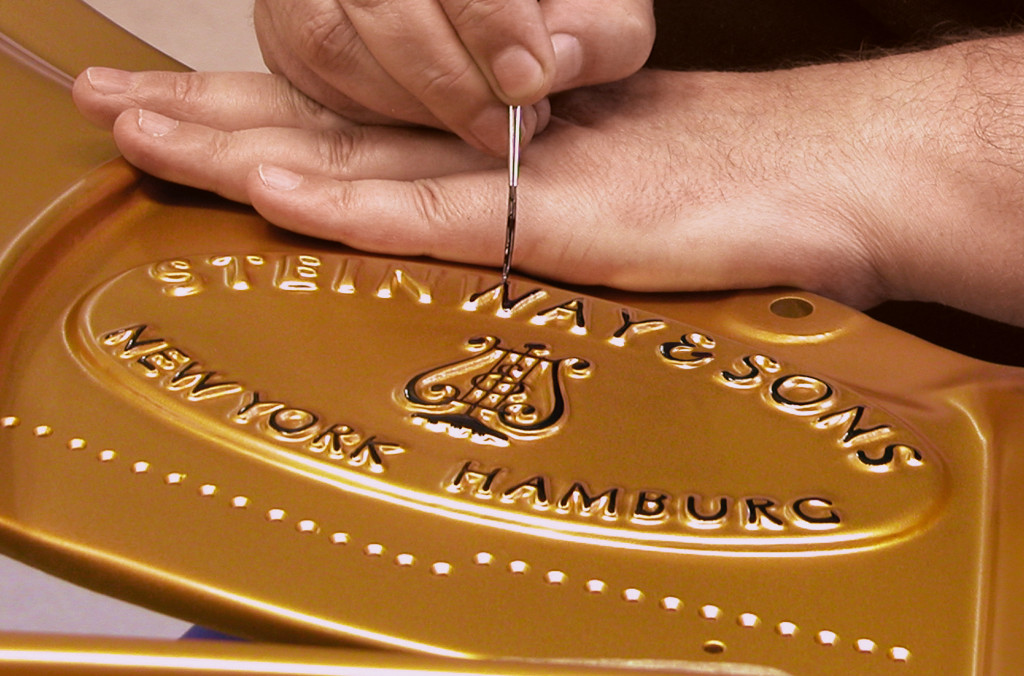 Steinway-Logo-painting-on-cast-iron-plate