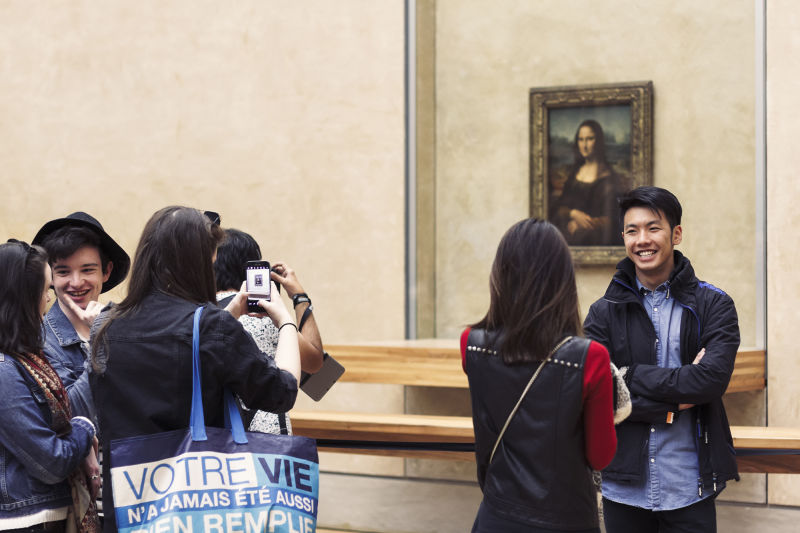 Everyone wants a picture with the Mona Lisa, but only by going late in the day can we get you a picture without everyone else in it.