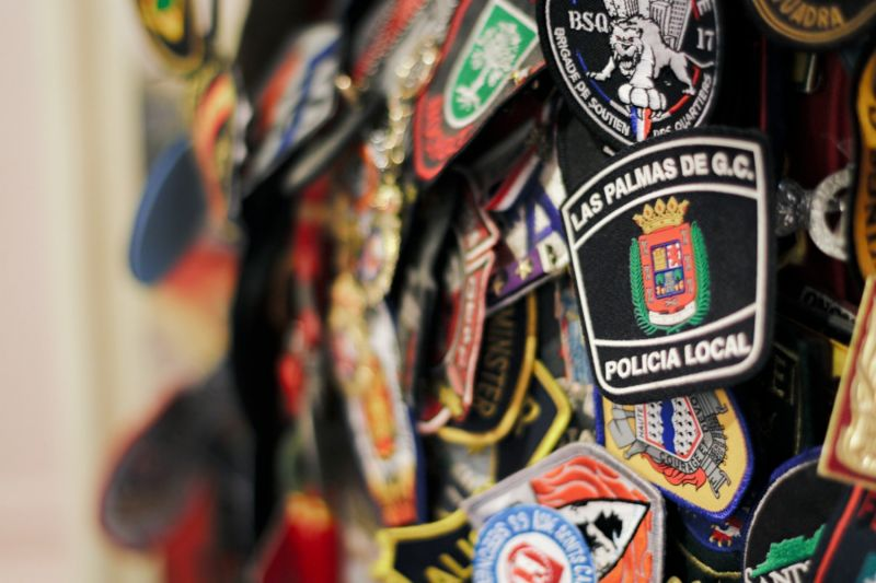 Badges from fire departments worldwide, left as a tribute in St Paul's Chapel