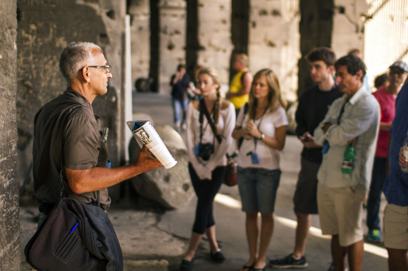 A Walks guide shows guests how the Colosseum looked nearly 2,000 years ago