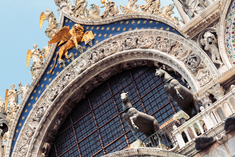 The facade of St. Mark's Cathedral includes four bronze horses that were taken from Constantinople, though today they are recreations - the originals are kept inside.