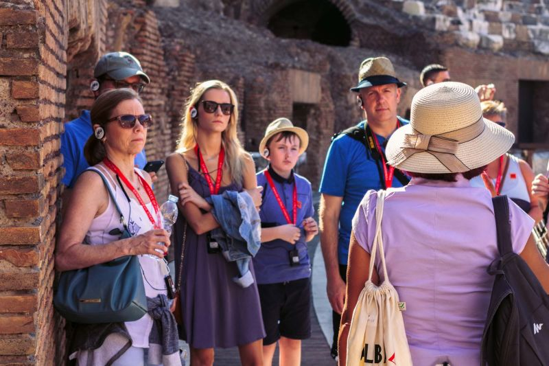 Learning the thrilling history of the Colosseum from an expert guide.
