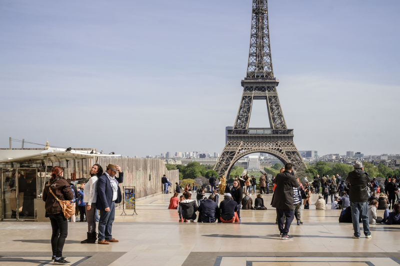 There is always a festival atmosphere around the Eiffel Tower.