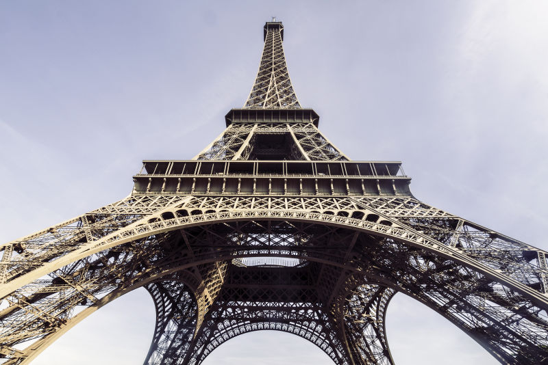It's hard to grasp the immensity of the Eiffel Tower until you stand beneath it.