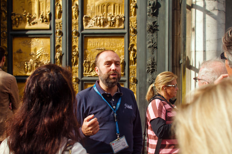 Showing off the famous Gates of Paradise on the Florence Baptistery