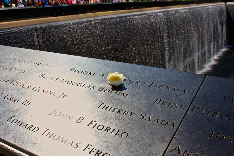 At the reflecting pools of the 9/11 memorial, a white rose is left on the name of each person killed in the attacks on their birthdays