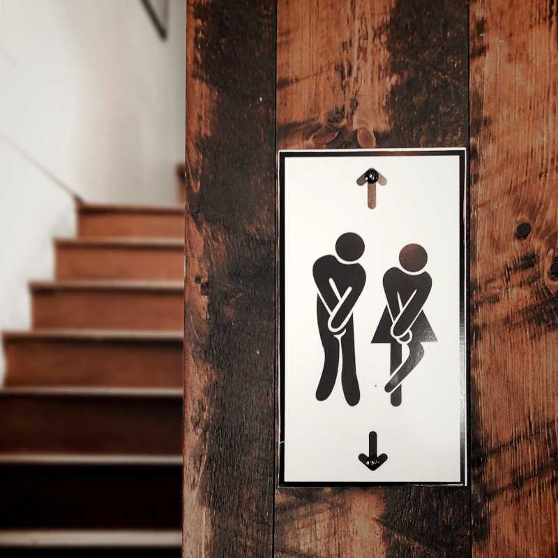 restroom sign: burning while peeing may be a sign of infection