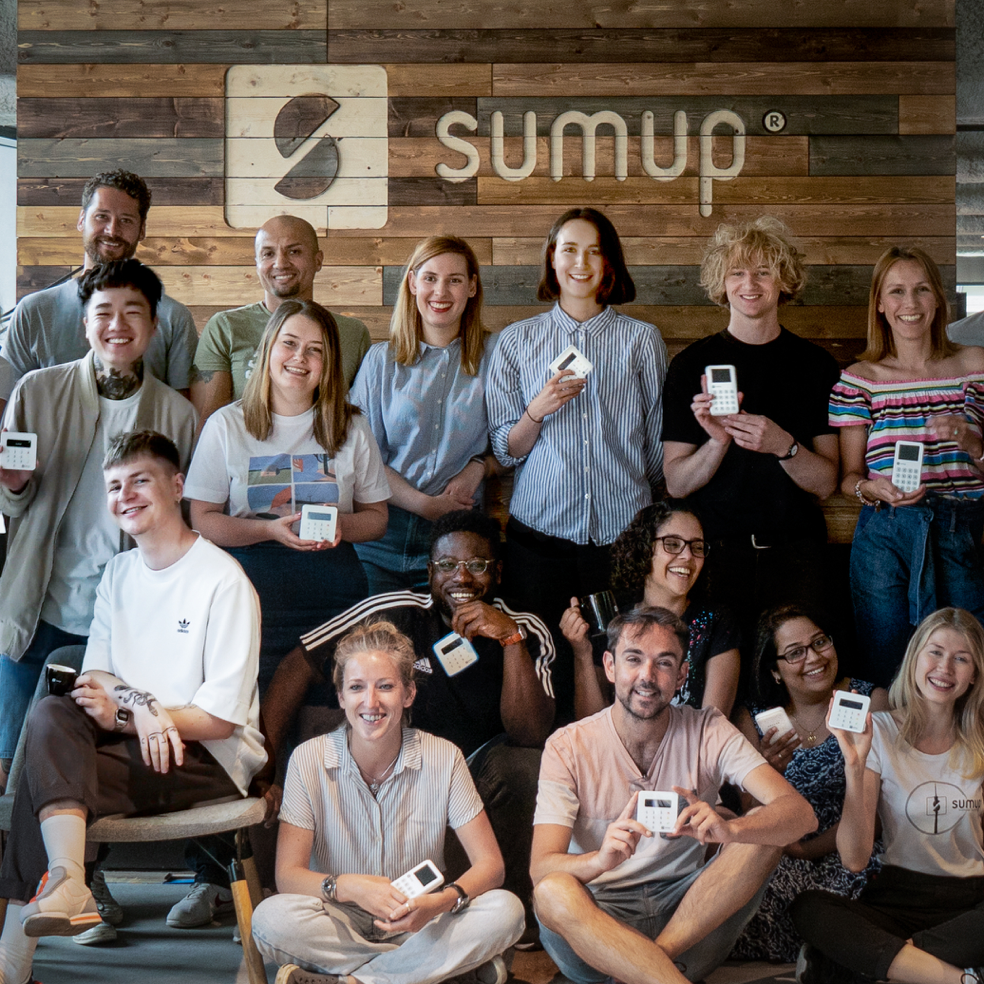 Photo of SumUp Team holding their card readers - cashless payment