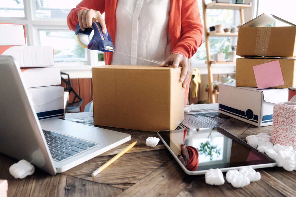 Online small business owner packing box