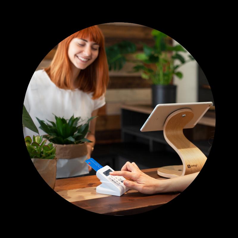 Photo of merchant and customer using SumUp card reader
