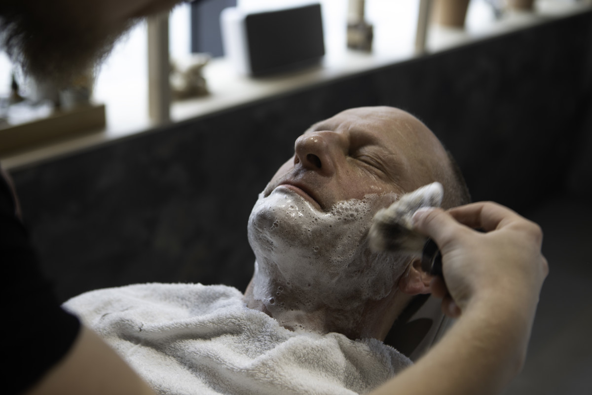 man-relaxing-shaving