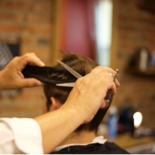 Barbour cuts man's hair