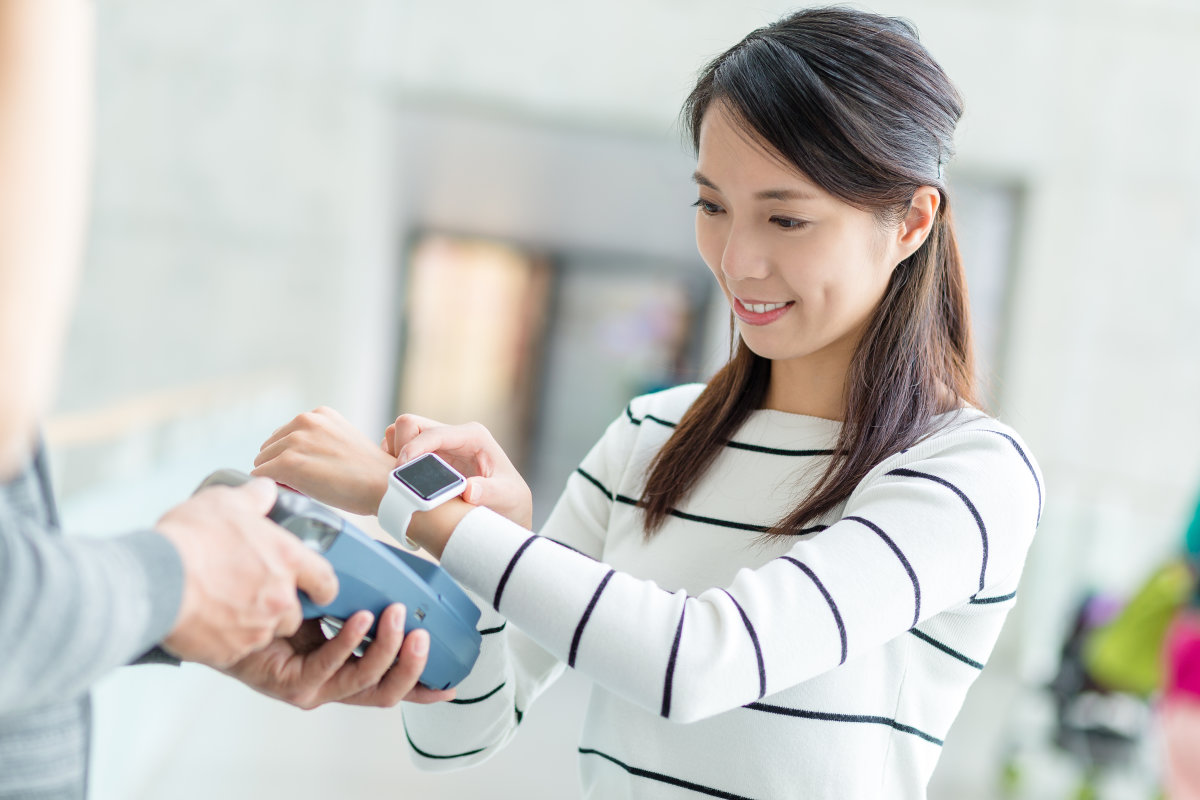 woman pays with wearable device - mobile payments