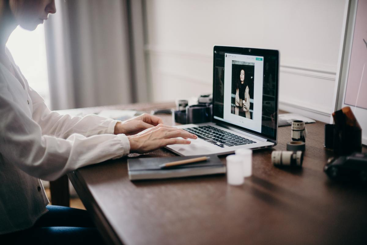 A photo of a woman looking at product photography