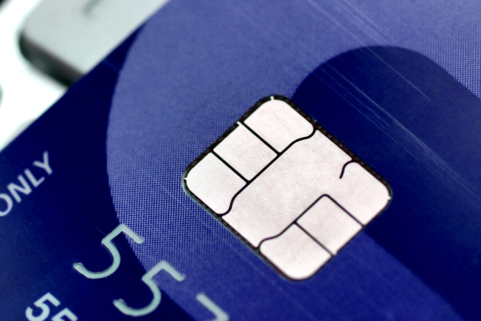 Close up image of a blue credit card with an EMV chip.