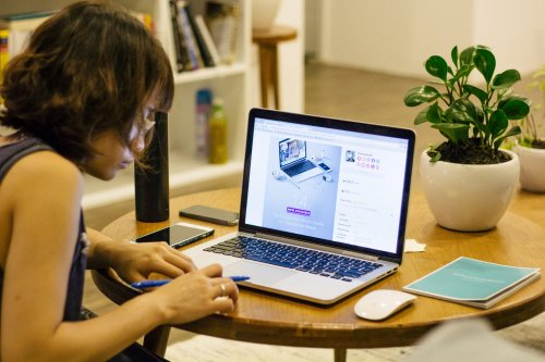 A photo of a woman browsing ecommerce website templates