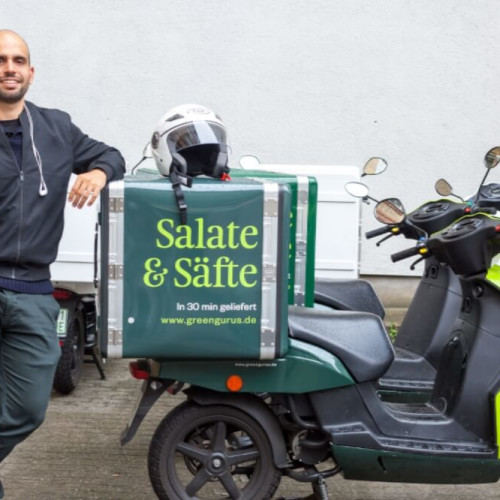 food delivery driver with moped