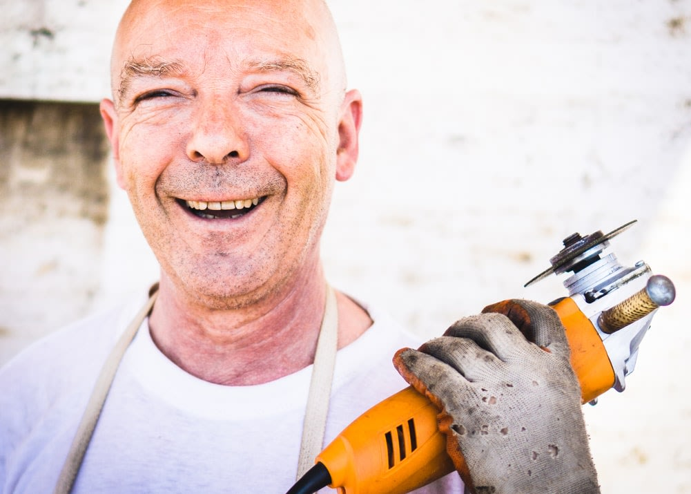 smiling man at work, doing what he loves