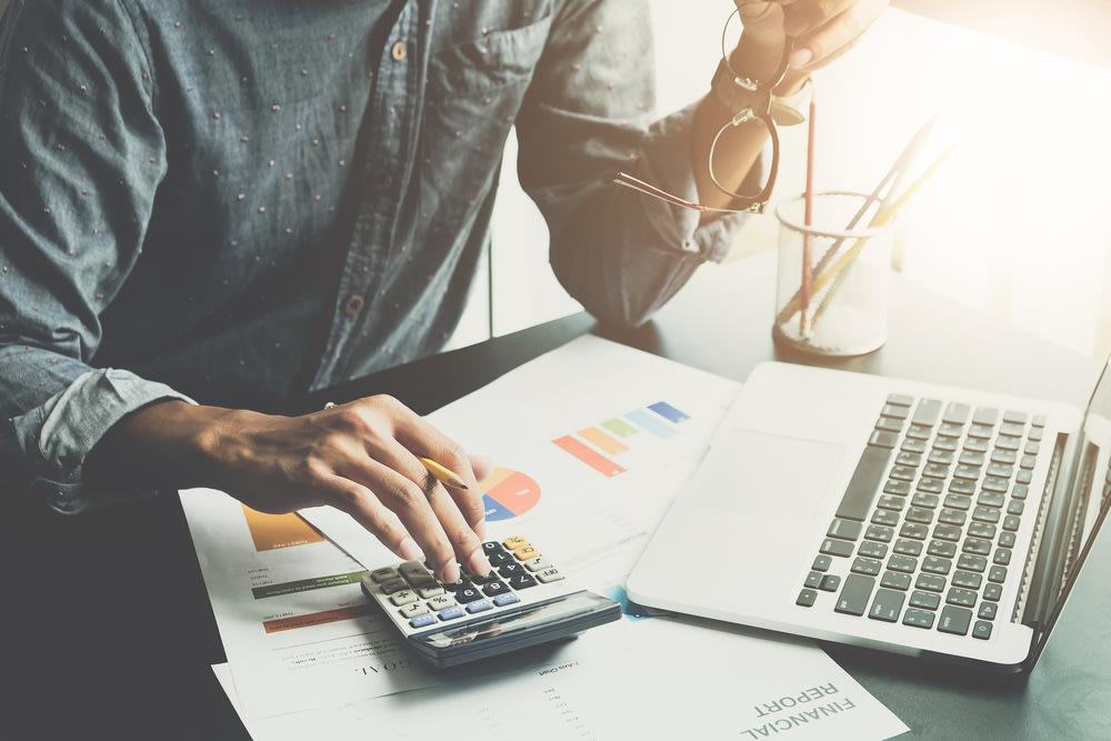 man working on financial analysis